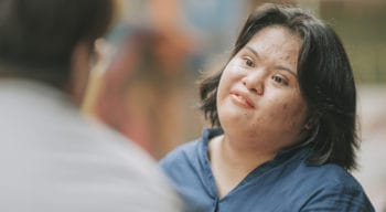 A young woman with a disability.